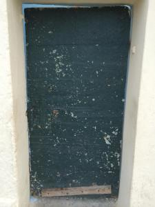 This door leads to an alleyway...